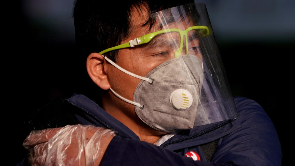 FILE PHOTO: A man wearing a mask is seen at the Shanghai railway station in Shanghai, China, as the country is hit by an outbreak of the novel coronavirus, February 12, 2020. REUTERS/Aly Song/File Photo