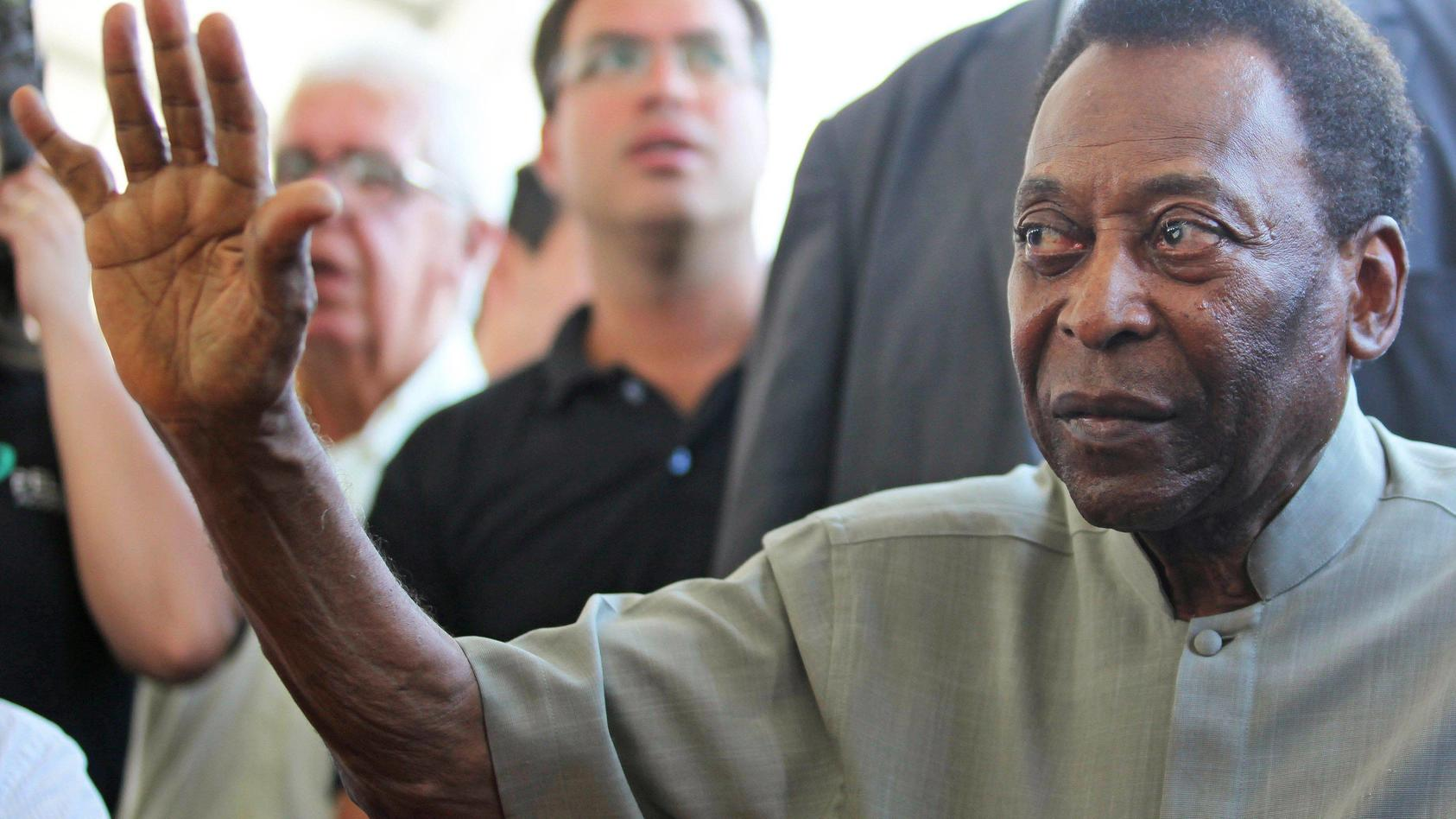 Brazilian former soccer player Pele , 78, greets during the opening of a soccer academy with his name at the Resende mu