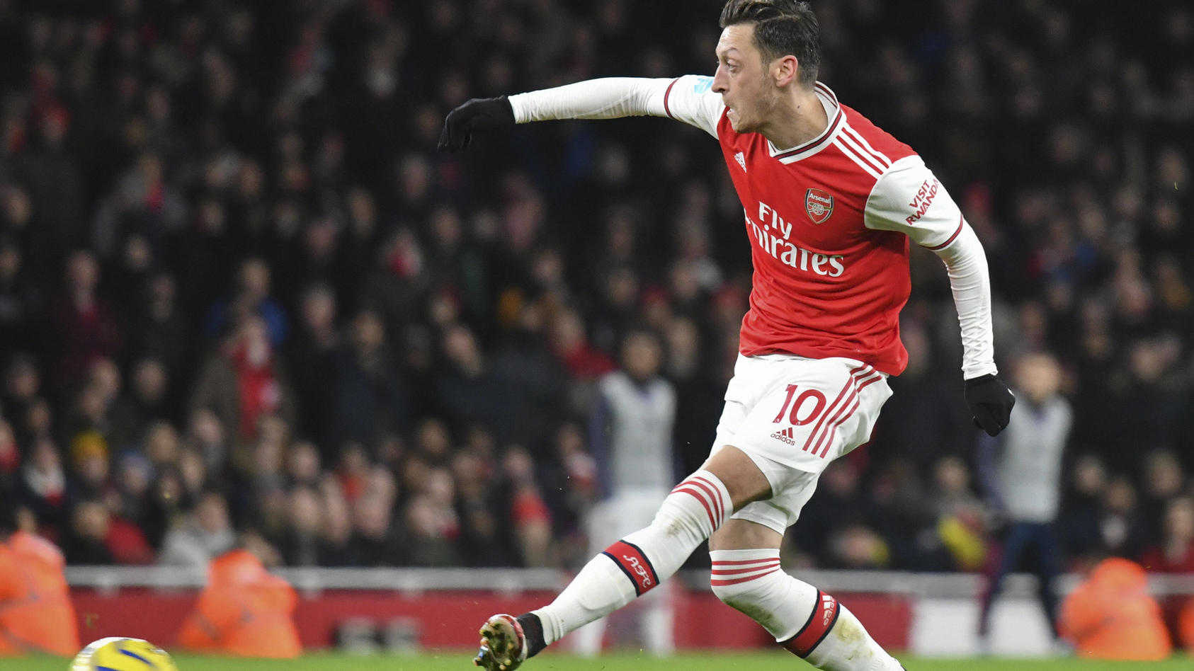 Football - 2019 / 2020 Premier League - Arsenal vs. Newcastle Mesut Özil of Arsenal scores his team s third goal, at Th