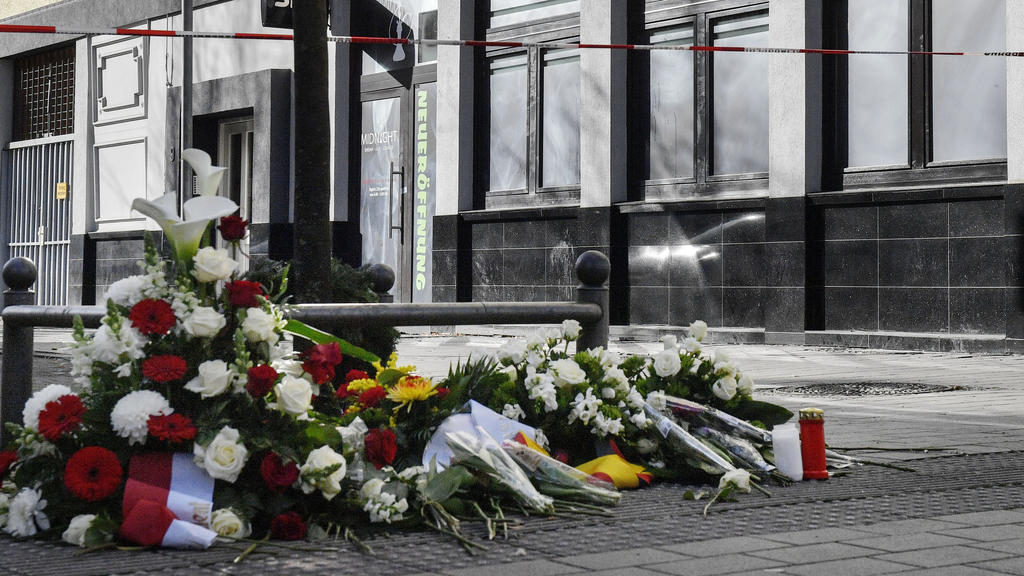 Flowers are seen in front of the hookah bar where a shooting took place in Hanau, Germany, Friday, Feb. 21, 2020 two days after a 43-year-old German man shot and killed several people at several locations in a Frankfurt suburb on Wednesday, Feb. 19,