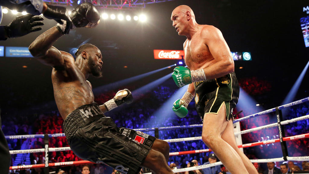 Boxing - Deontay Wilder v Tyson Fury - WBC Heavyweight Title - The Grand Garden Arena at MGM Grand, Las Vegas, United States - February 22, 2020 Tyson Fury knocks down Deontay Wilder during the fight REUTERS/Steve Marcus     TPX IMAGES OF THE DAY