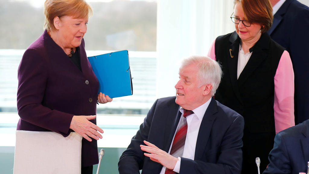 German Interior Minister Horst Seehofer refuses to shake the hand of German Chancellor Angela Merkel for hygienic reasons before a migration summit at the Chancellery in Berlin, Germany, March 2, 2020. REUTERS/Hannibal Hanschke     TPX IMAGES OF THE