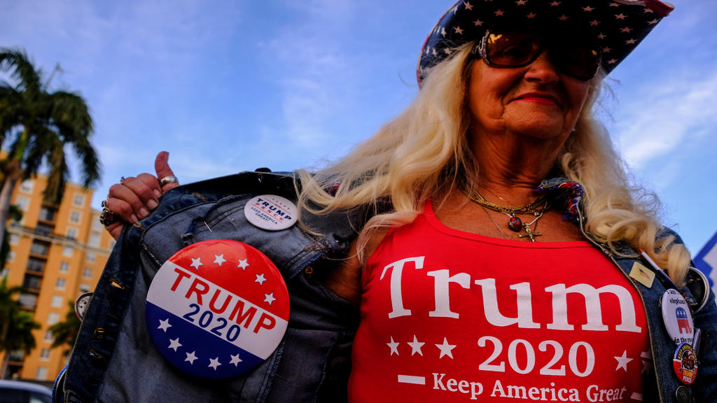 Kathy Clark wears merchandise supporting U.S. President Donald Trump outside the convention center where Democratic U.S. presidential candidate Michael Bloomberg is holding his Super Tuesday night rally, in West Palm Beach, Florida, U.S., March 3, 20
