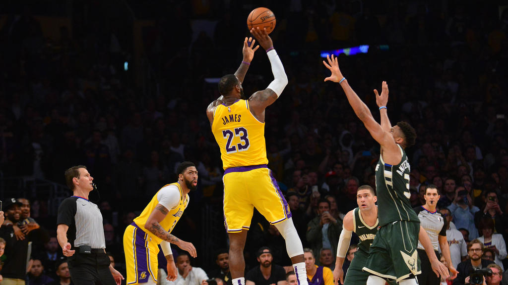 March 6, 2020; Los Angeles, California, USA; Los Angeles Lakers forward LeBron James (23) shoots against Milwaukee Bucks forward Giannis Antetokounmpo (34) during the second half at Staples Center. Mandatory Credit: Gary A. Vasquez-USA TODAY Sports