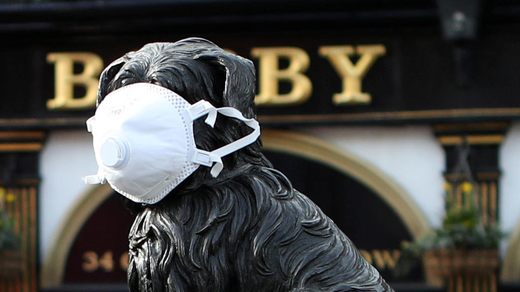 The Greyfriars Bobby statue is pictured wearing a mask as the spread of the coronavirus disease (COVID-19) continues, in Edinburgh, Scotland, Britain, March 23, 2020. REUTERS/Russell Cheyne