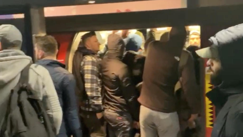 People get into a crowded underground train at North Greenwich Station, as the spread of the coronavirus disease (COVID-19) continues, in London, Britain March 23, 2020, in this still image obtained from a social media video. Peter Fellows/via REUTER
