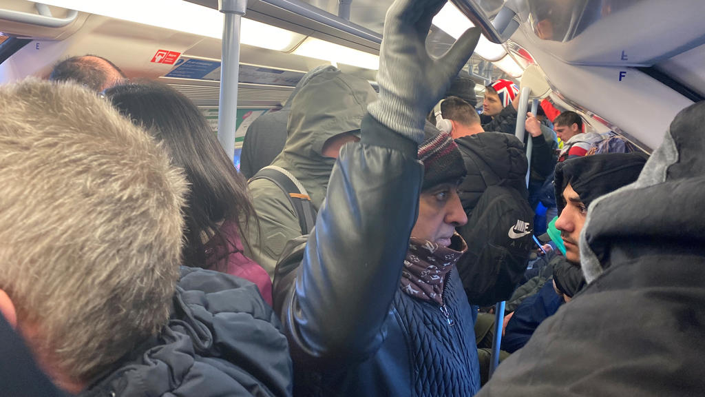 People ride on a crowded underground train, as the spread of the coronavirus disease (COVID-19) continues, in London, Britain March 23, 2020, in this picture obtained from social media. Peter Fellows/via REUTERS    NO RESALES. NO ARCHIVES. THIS IMAGE