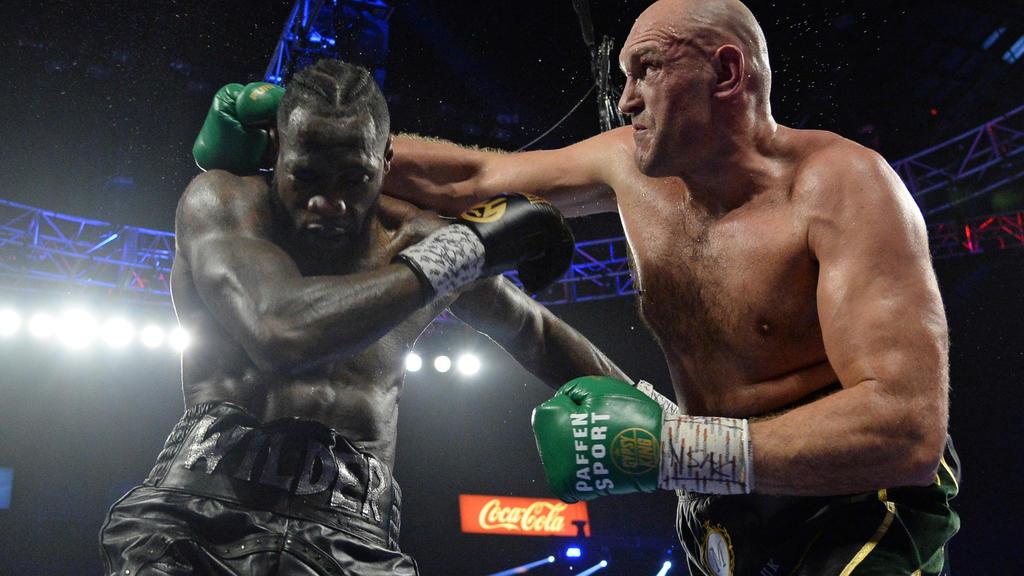 FILE PHOTO: Feb 22, 2020; Las Vegas, Nevada, USA; Deontay Wilder and Tyson Fury box during their WBC heavyweight title bout at MGM Grand Garden Arena. Fury won via seventh round TKO. Mandatory Credit: Joe Camporeale-USA TODAY Sports/File Photo