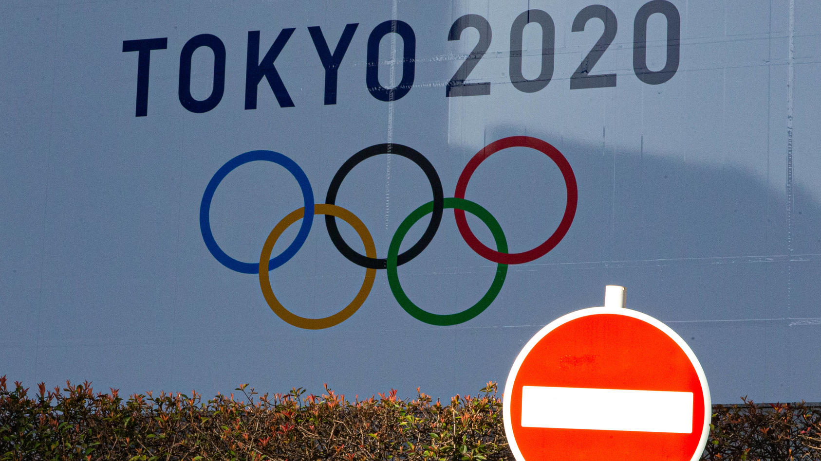 A large display promoting the Tokyo 2020 Olympics is seen in Tokyo, Japan on March 25, 2020, a day after the Tokyo 2020