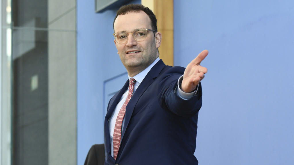 German Health Minister Jens Spahn arrives for a news conference about the spread of coronavirus disease in Berlin, Germany, Thursday, March 26, 2020. The new coronavirus causes mild or moderate symptoms for most people, but for some, especially older