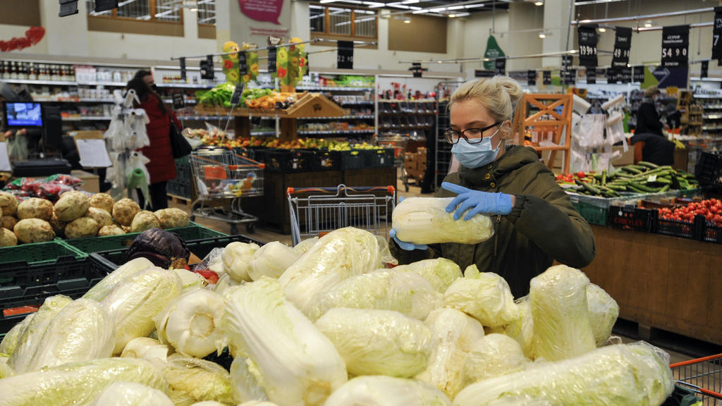 March 24, 2020, Kiev, Ukraine: A woman wearing a protective mask as a precaution against Coronavirus, buying vegetables in a supermarket..97 cases of COVID-19 infection in Ukraine have been reported by Ministry of Health Ukraine. Kiev Ukraine - ZUMA