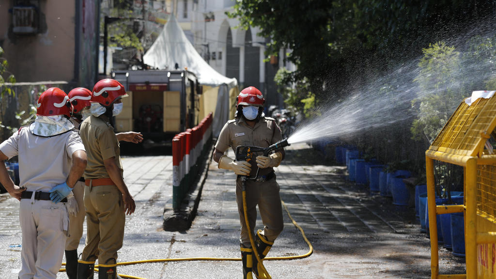 Delhi fire officers disinfect an area at Nizamuddin, from where several people who attended an Islamic congregation earlier this month were tested positive for Covid-19, in New Delhi, India, Thursday, April 2, 2020. Police in New Delhi have filed a c