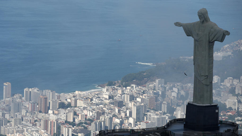 An aerial view shows the Christ the Redeemer statue with the Copacabana beach during the coronavirus disease (COVID-19) outbreak, in Rio de Janeiro, Brazil, March 26, 2020.  REUTERS/Ricardo Moraes