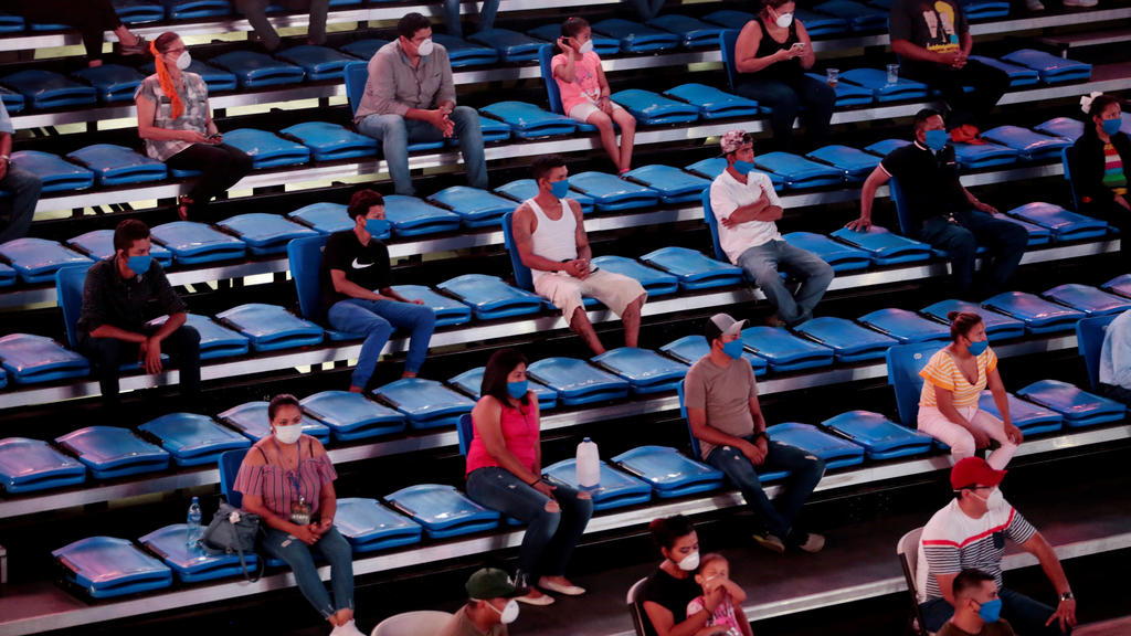 Boxing - Bufalo Boxing - Polideportivo Alexis Arguello, Managua, Nicaragua - April 25, 2020   Fans wearing protective face masks are seated with social distancing, despite most sport being cancelled around the world as the spread of the coronavirus d