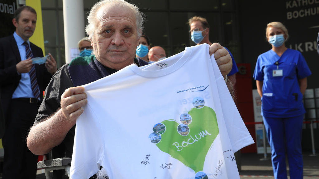 Claudio Facoetti, a 65-year-old man from the northern Italian city of Bergamo, near Milan, holds a T-shirt signed by the intensive care nurses of the Saint Josef university clinic after he recovered within six weeks from the coronavirus disease (COVI