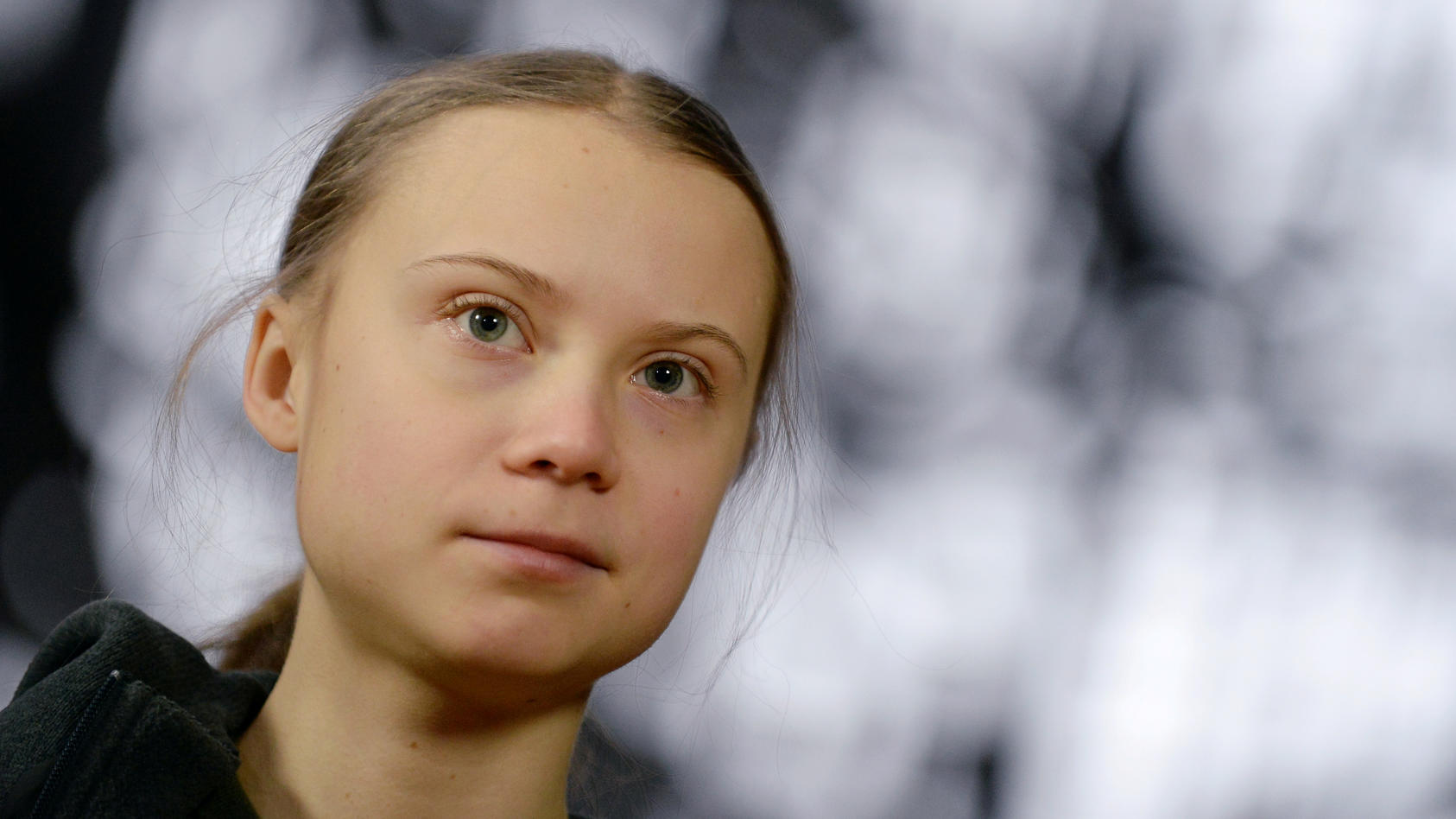 FILE PHOTO: Swedish climate activist Greta Thunberg talks to the media before meeting with EU environment ministers in Brussels
