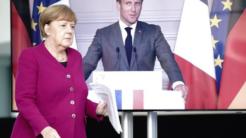 Bundeskanzlerin Angela Merkel (CDU) und Frankreichs Präsident Emmanuel Macron auf einer Pressekonferenz. Foto: Kay Nietfeld/dpa-Pool/dpa