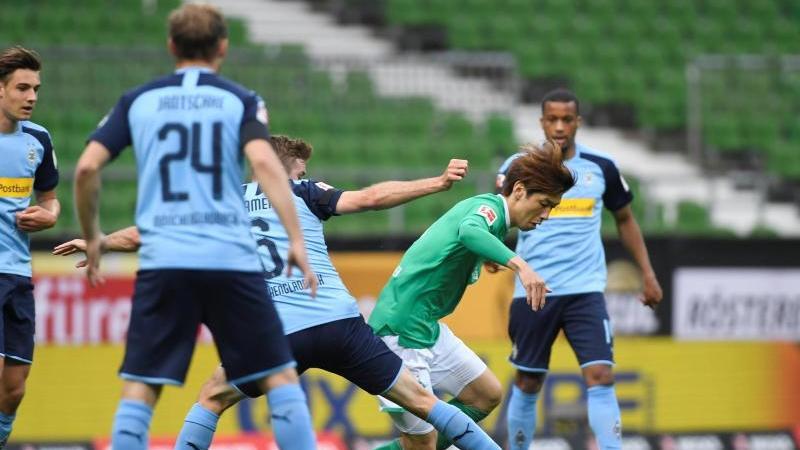 Werder Bremens und Borussia Mönchengladbach teilten sich die Punkte. Foto: Fabian Bimmer/reuters - Pool/dpa