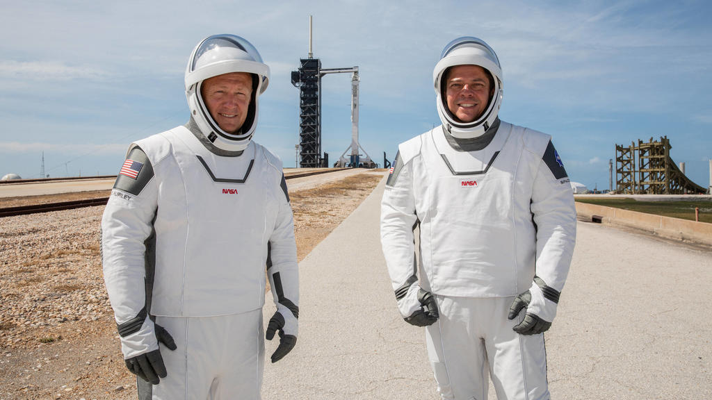 NASA astronauts Douglas Hurley left and Robert Behnken right participate in a dress rehearsal for launch at the agency s Kennedy Space Center in Florida on May 23, 2020, ahead of NASA s SpaceX Demo-2 mission to the International Space Station. Demo-