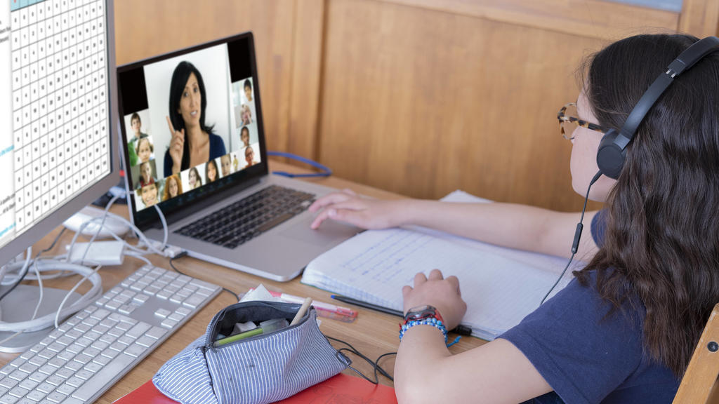 Girl attending online school classes from home Copyright: FrdricxCirou B91310842