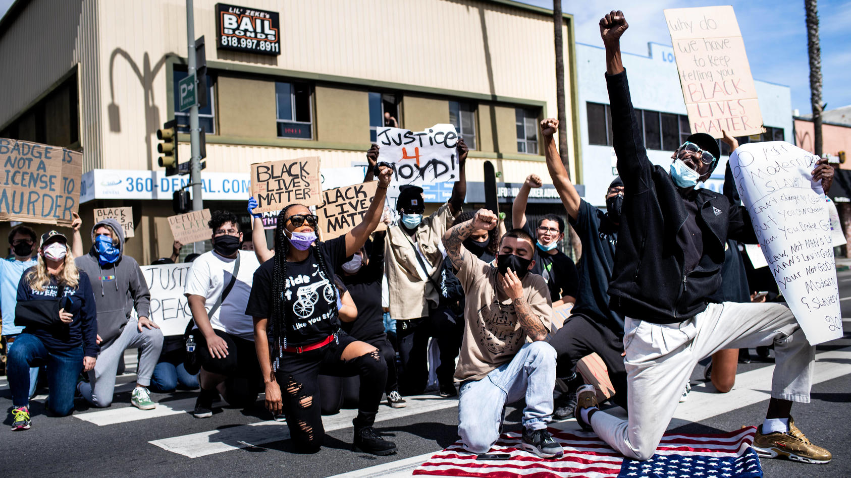 June 1, 2020, Van Nuys, California, USA: Protesters take a knee on Van Nuys Boulevard during a peaceful protest with Bl