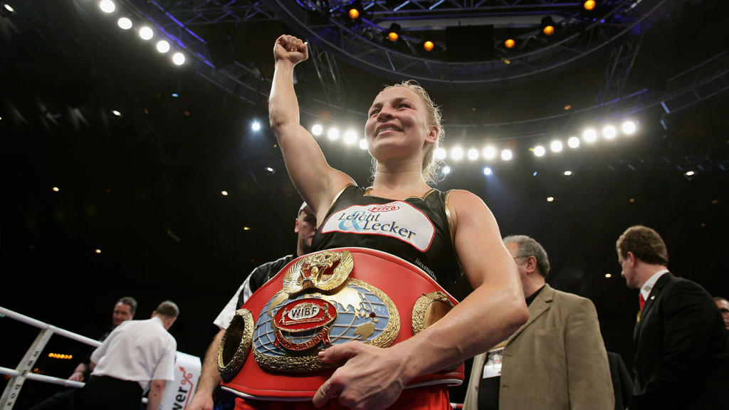 KARLSRUHE, GERMANY - NOVEMBER 30:  Regina Halmich of Germany celebrates after beating Hagar Shmoulefeld Finer of Israel in defense of her WIBF World Championship flyweight title at the DM Arena on November 30, 2007 in Karlsruhe, Germany. Halmich has