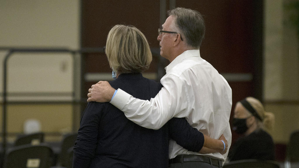 Gay and Bob Hardwick who were attacked in their Stockton home in 1978 by Golden State Killer, Joseph James DeAngelo, stand as the charges are read against DeAngelo during a hearing in Sacramento Superior Court in Sacramento, Calif. Monday June 29, 20
