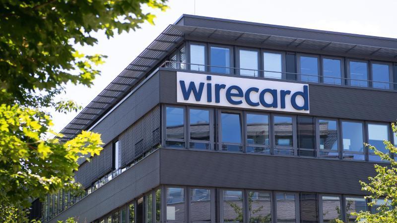 Der Schriftzug von Wirecard an der Firmenzentrale des Zahlungsdienstleisters. Foto: Sven Hoppe/dpa/Archivbild