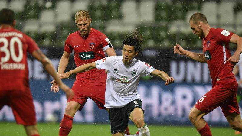 Das Relegations-Rückspiel zwischen dem 1. FC Heidenheim und Werder Bremen verspricht viel Spannung. Foto: Martin Meissner/AP POOL/dpa