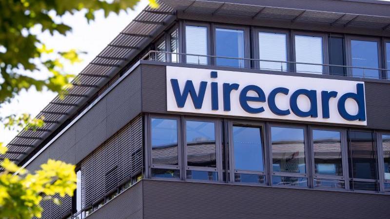 Der Schriftzug von Wirecard ist an der Firmenzentrale zu sehen. Foto: Sven Hoppe/dpa/Symbolbild