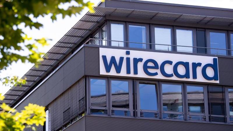 Der Schriftzug von Wirecard ist an der Firmenzentrale des Zahlungsdienstleisters zu sehen. Foto: Sven Hoppe/dpa