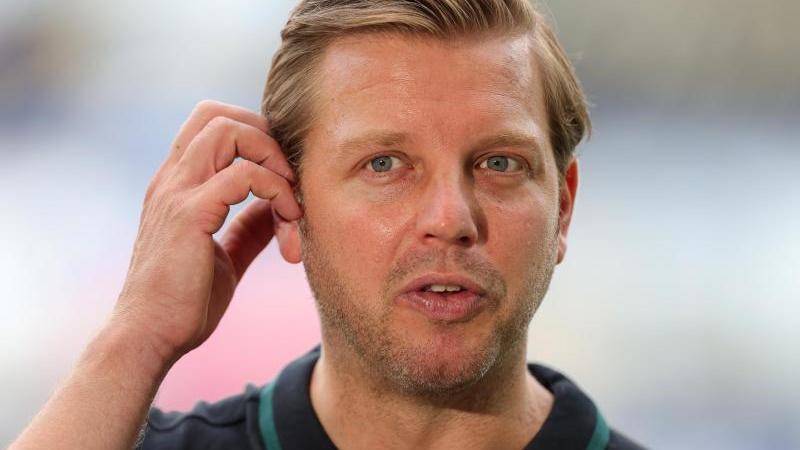 Florian Kohfeldt bleibt Trainer bei Werder Bremen. Foto: Friedemann Vogel/EPA/Pool/dpa/Archivbild