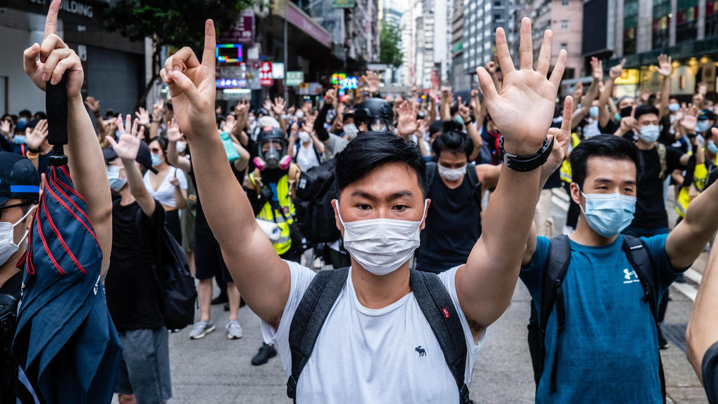 July 1, 2020, Hong Kong, China: Protesters making gestures of 1 and 5 fingers, symbolising the five demands of the protest movement during the demonstration..Following the passing of the National Security Law that would tighten on freedom of expressi