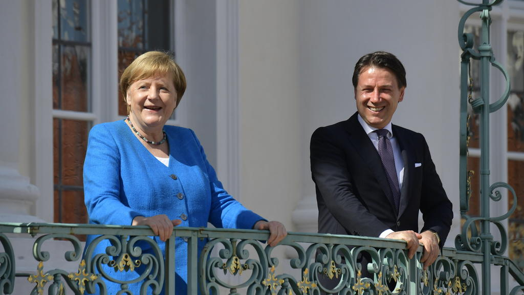 German Chancellor Angela Merkel, left, and Italian Prime Minister Guiseppe Conte, right, talk prior to a meeting at the German government's guest house 'Meseberg' in Gransee, north of Berlin, Germany, Monday, July 13, 2020. (Tobias Schwarz/Pool Photo