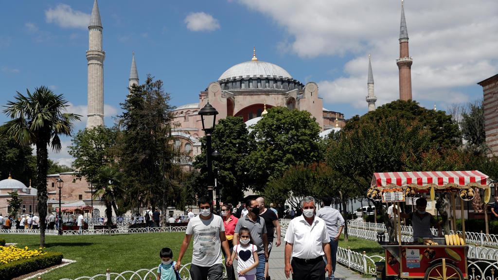 People stroll at Sultanahmet Square near Hagia Sophia, or Ayasofya-i Kebir Camii, in Istanbul, Turkey, July 11, 2020. REUTERS/Murad Sezer