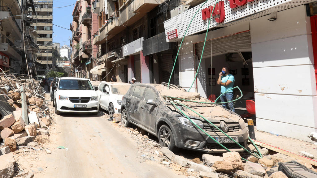 Lebanese inspect the damage of a massive explosion in Lebanon s capital Beirut, on Wednesday, on August 5, 2020. Rescuers worked through the night after two enormous explosions ripped through Beirut s port on August 4th, killing at least 100 people a