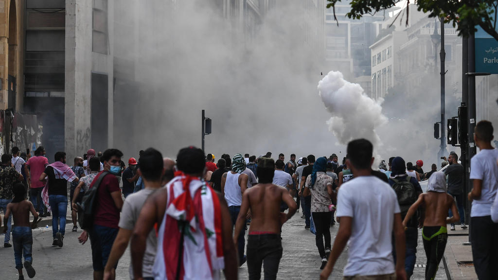BEIRUT, LEBANON - AUGUST 8, 2020: People take part in a protest on a city street, demanding the resignation of the government led by Prime Minister Hassan Diab and early parliamentary election. The August 4 explosion in the port area of Beirut resul