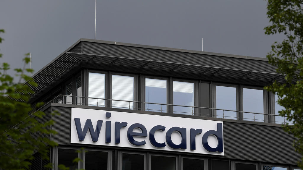 FILE PHOTO: The logo of Wirecard AG is pictured at its headquarters in Aschheim, near Munich, Germany, July 1, 2020. REUTERS/Andreas Gebert/File Photo  GLOBAL BUSINESS WEEK AHEAD
