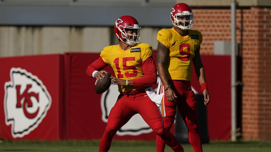 Kansas City Chiefs quarterback Patrick Mahomes throws while quarterback Jordan Ta'amu (9) watches during an NFL football training camp practice Thursday, Aug. 27, 2020, in Kansas City, Mo. (AP Photo/Charlie Riedel)