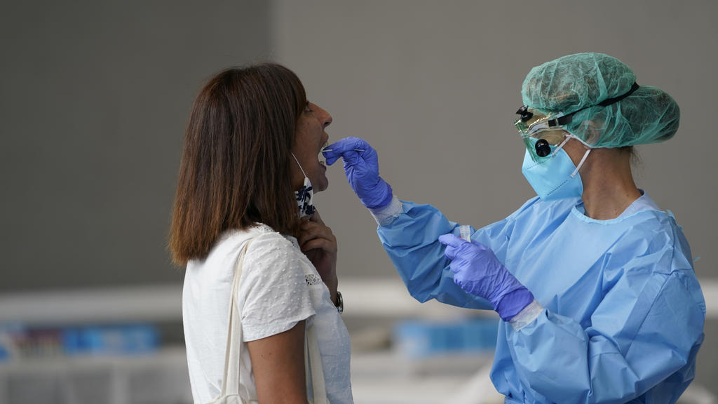 A medical worker administers a PCR test to a resident of the Basque town of Azpeitia, Spain, amid a localised outbreak of the coronavirus disease (COVID-19), August 17, 2020. REUTERS/Vincent West