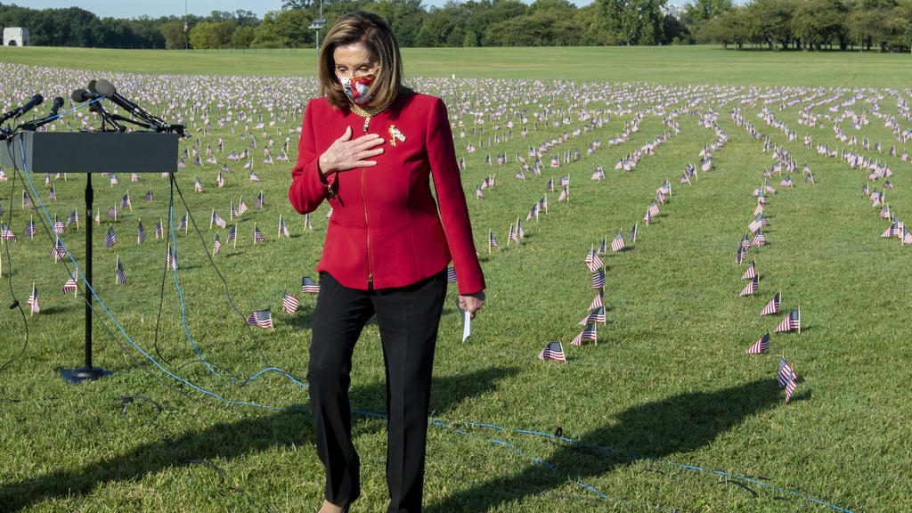 House Speaker Nancy Pelosi takes part during an event commemorating the 200,000 Americans that have lost their lives due to the Covid-19 pandemic, on the National Mall in Washington, DC on Tuesday, September 22, 2020. Some 20,000 American flags were