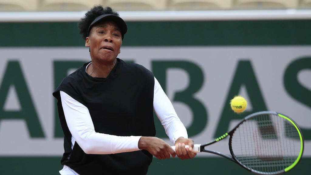 Venus Williams of the U.S. plays a shot against Slovakia's Anna Karolina Schmiedlova in the first round match of the French Open tennis tournament at the Roland Garros stadium in Paris, France, Sunday, Sept. 27, 2020. (AP Photo/Michel Euler)