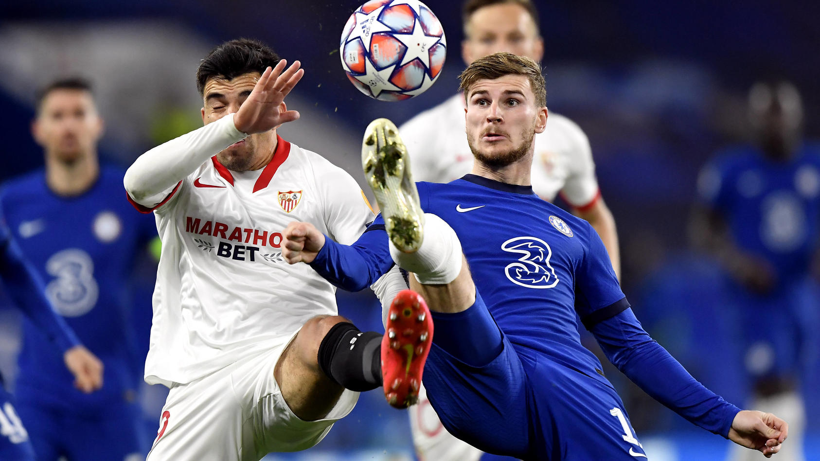 Chelsea v Sevilla - UEFA Champions League - Group E - Stamford Bridge Sevilla s Marcos Acuna (left) and Chelsea s Timo