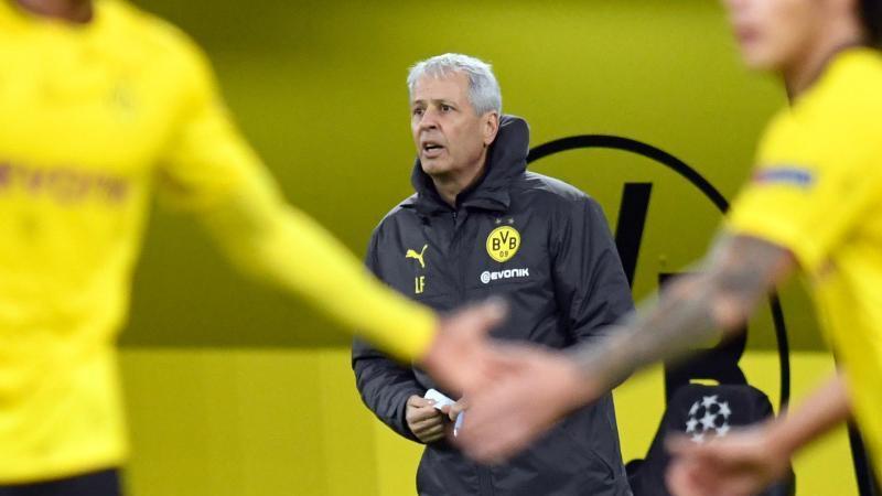 War trotz des glanzlosen Sieges sehr zufrieden:Dortmunds Trainer Lucien Favre. Foto: Bernd Thissen/dpa