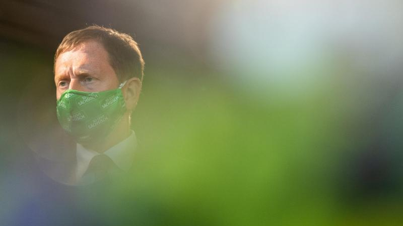 Michael Kretschmer, der Ministerpräsident von Sachsen, mit Mund-Nasen-Schutz. Foto: Robert Michael/dpa-Zentralbild/dpa/Archivbild