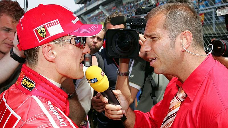 German Formula One driver Michael Schumacher (L) of Scuderia Ferrari answers questions of German TV-presentator Kai Ebel before the Grand Prix of Spain at the F1 race track Circuit de Catalunya in Montmelo near Barcelona, Spain, Sunday 14 May 2006. P