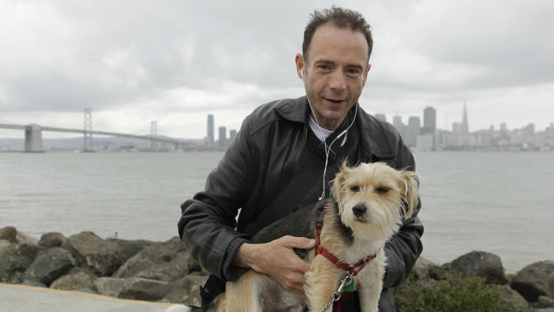 This May 16, 2011 photo shows Timothy Ray Brown, the only man ever known to have been apparently cured from AIDS, with his dog, Jack, on Treasure Island in San Francisco. Brown was in a Berlin hospital in 2007, worrying whether leukemia or the AIDS v