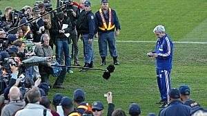 epa02213009 French Coach Raymond Domenech reads a statement prepared by the team to the media gathered at the training pitch in Knysna, South Africa, 20 June 2010. The team arrived at a open training and greeted members of the public, only to then re