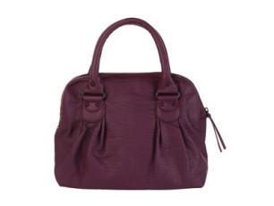 Bruce Darnells Styling-Tipp No. 1: Die Handtasche