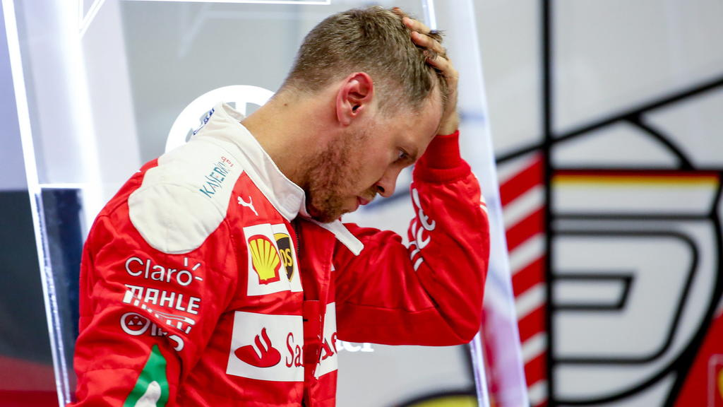 epa05544185 German Formula One driver Sebastian Vettel of Scuderia Ferrari walks out of the garage at the end of the third practice session for the Singapore Formula One Grand Prix night race at the Marina Bay Street Circuit in Singapore, 17 Septembe